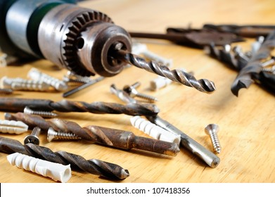 Drill and screw on wooden table