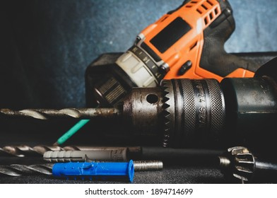 Drill and screwdriver drill set, carpentry tools, home repair concept on dark background, work tools