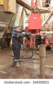 The driller operates the tool on workplace