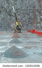 Driller in a Porphyry mine quarry. industrial tools.