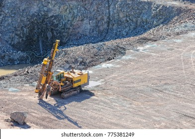 driller in a quarry mine exploring rock material