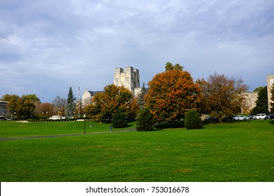 Drillfield view with Burrus Hall in the background during the fall with orange and maroon colored trees at Virginia Tech University, Blacksburg, VA, USA