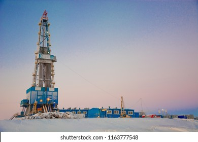 Drilling a deep well with a drilling rig at an oil and gas field. The deposit is located in the Far North beyond the Arctic Circle. The shooting was conducted in the winter during the polar day