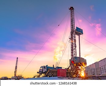Drilling a deep well with a drilling rig in an oil and gas field. The field is located in the Far North beyond the Arctic Circle. The shooting took place in the winter on a polar day.