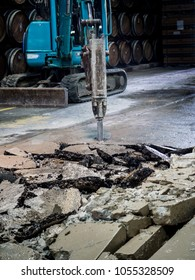 Drilling Machine, The jackhammer, has been penetrated into the concrete floor.