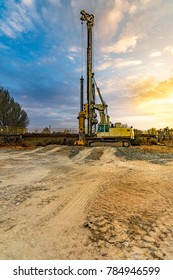 Drilling machine making holes to lift pillars in the construction of a bridge in Zamora (Spain)