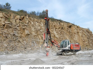 Drilling machine in open cast mining quarry