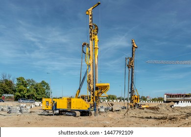 Drilling machines ready to drill piles on a road building site. Road building background. Horizontal image