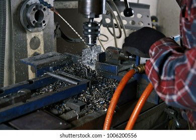 Drilling, a man working on a liquid-cooled drill.