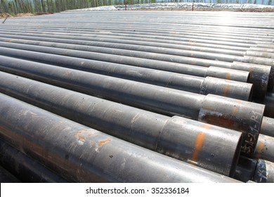 drilling pipes stacked near rig