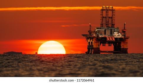 drilling platform on the ocean during sunrise