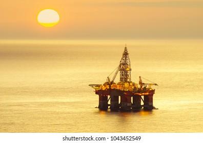 drilling platform on the sea at sunrise