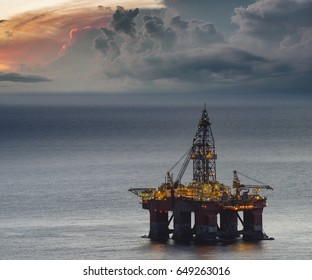 Drilling rig on the ocean at storm