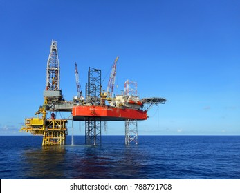 Drilling rig on oil production platform view with blue sky background in offshore oil field