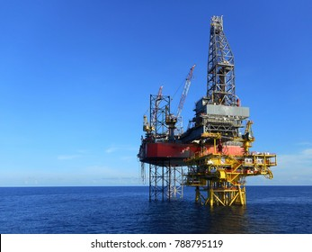 Drilling rig on oil production platform view with beautiful blue sky background in oil and gas offshore field