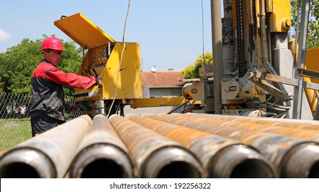 Drilling Rig Operator. Oil and gas industry. Oil and gas well drilling worker operate drilling rig machinery.