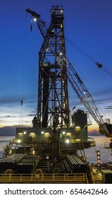 Drilling rig silhouette view with background sunset sky in blue hous