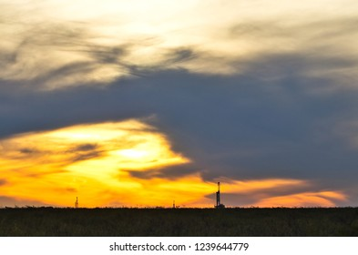 drilling rig at sunset in the Permian Basin