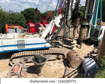 drilling rigs at construction site. Industrial drilling rig machinery on highway construction site. Viaduct construction and bridge pillar details. boring holes in ground with drilling rig