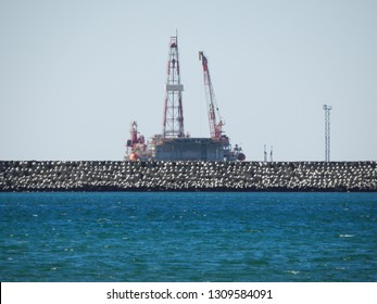 Drilling tower on the shore of the Caspian Sea. Kazakhstan.