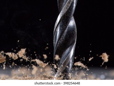 Drilling wooden plank, close-up.