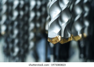 Drills for drilling concrete in a shop window of a hardware store. Close-up. Selective focus