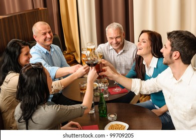 Drink after work business people toasting at restaurant have fun