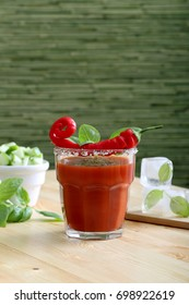 drink or cocktail with tomato juice and red hot chilli pepper
