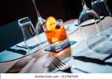 drink coktail close up with dried fruit on restaurant table with tools