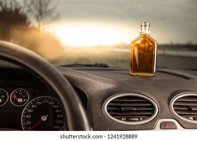 Drink and drive. Bottle of alcohol inside the car. Don't Drink for Drive