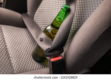 Drink and drive. Bottle of beer inside the car. Don't Drink for Drive