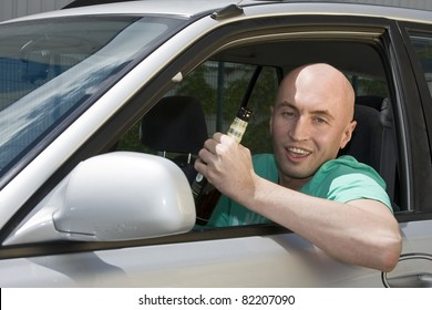 Drink and drive man with alcohol in car