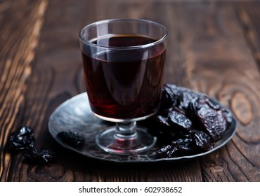 drink from dry plum and plums