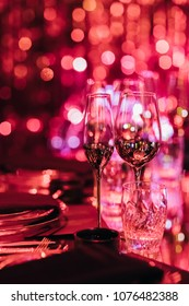 Drink glasses and dishes in blurred light for party