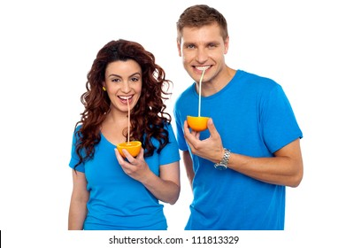 Drink healthy, stay healthy. Attractive couple drinking fresh orange juice