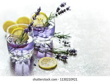 Drink with lemon and lavender flowers. Cold summer lemonade