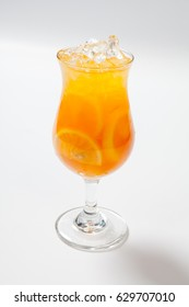 Drink with lemon, orange and ice on white background.