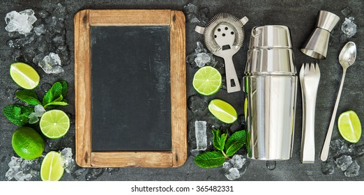 Drink making tools and ingredientsLime and mint leaves. Blackboard for recipe
