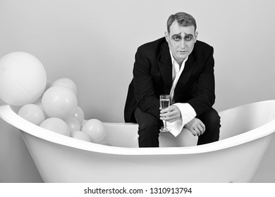 The drink of the moment. Mime man celebrate with champagne in bath. Comedian actor enjoy theatre party celebrating. Mime actor has celebration party. Think celebration, think champagne.