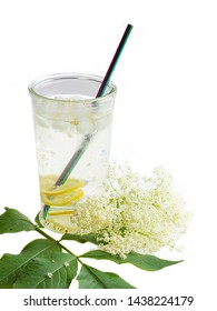 Drink from sambucus with slices of lemon. With ice cube and unplastic straw. A very delicious and refreshing drink for hot summer days. Vertical photo isolated on the white background.