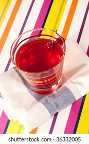 drink series: glass of cherry beverage on the napkin