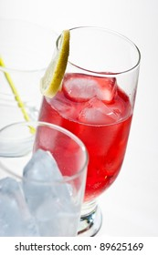 drink series: red cocktail with ice and lemon