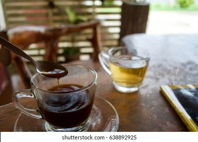 Drink tea and coffee with read books on wooden table