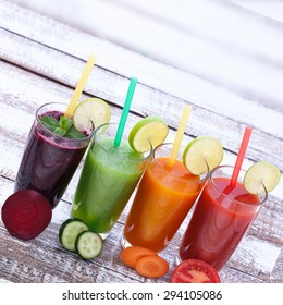 Drink vegetable in glasses on wooden table. Smoothies from vegetables for breakfast