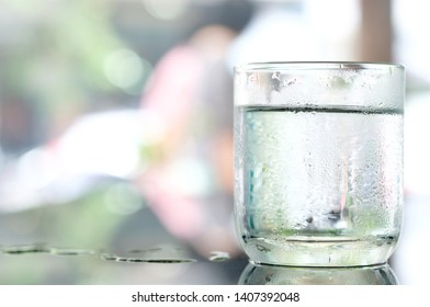 Drink Water cool.  Pure water in the glass on the table. Health concept