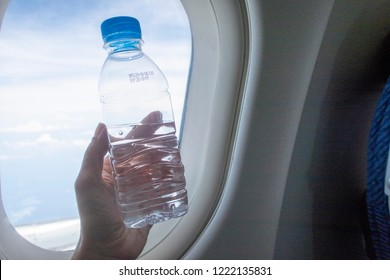 Drink water on plane. To prevent dehydrate your body when travel on the aircraft. Dehydrate concept for traveler.