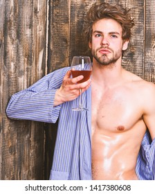 Drink wine and relax. Bachelor enjoy wine. Macho tousled hair degustate luxury wine. Erotic and desire concept. Guy attractive relaxing with alcohol drink. Man sexy chest sweaty skin hold wineglass.