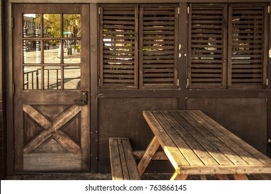 Drinking bar façade in brown wood with table