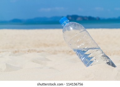 drinking bottle on the beach in sunny day