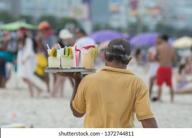 drinking caipirinha, caipifruta and cocktails on Copacabana beach in Rio de Janeiro Brasil Vendors on Ipanema beach